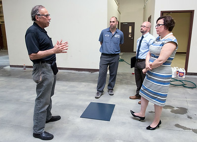 06/25/18  Wesley Bunnell | Staff  Owner Ron Weintraub, L, from Curtis Products speaks with Bristol Mayor Ellen Zoppo-Sassu, R, during a tour highlighting the renovation of their new Bristol location on Monday afternoon as Production Manager Brad Vilcheck, center, and Executive Director of Bristol Development Authority Justin Malley look on. The Bristol Development Authority has awarded grants to help businesses expand and relocate to town.