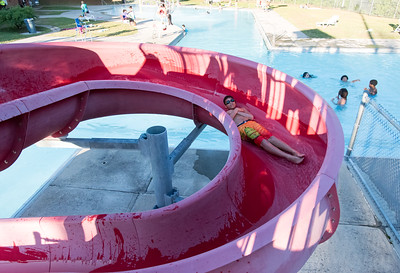 06/25/18  Wesley Bunnell | Staff  Trey Montgomery , age 12, travels around the loop on the water slide at the Willow Brook Park Pool on Monday evening.