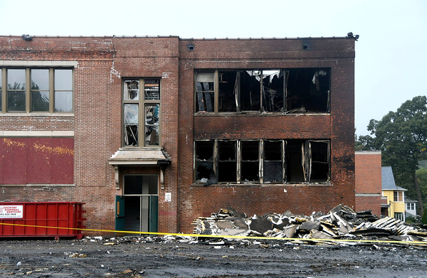 10/14/2017 Mike Orazzi | Staff The scene of a large blaze at the old O'Connell elementary school, police said. The fire was called in at 1:08 a.m. by several people, police said. Firefighters arrived to find a &quote;large scale&quote; working fire that heavily damaged the building and some building materials, police said. No injuries were reported. The cause of the fire is under &quote;active investigation,&quote; according to police who declined to give out further details. Council members voted to sell the old elementary school at 120 Park St. for redevelopment in 2015. The school has not been used since 2012. The plan was to turn the old school into 49 units of housing which was supposed to be finished in spring of 2017.