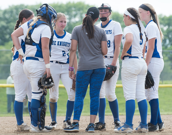 06/01/18 Wesley Bunnell | Staff Southington defeated South Windsor 1-0 on Friday afternoon to advance to the Class LL Semi Final Tournament game. Head Coach Davina Hernandez, center, addresses the team during a time out on the mound. Catcher Abigail Lamson (17), Chrissy Marotto (2), pitcher Kara Zazzaro (18) and Frankie Ferrante (5).