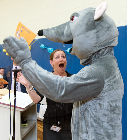 06/01/18 Wesley Bunnell | Staff Lincoln Elementary School Principal Lisa Torres reacts as a mouse enters the school gymnasium on Friday afternoon. Lincoln Elementary School held their One School, One Book event on Friday afternoon giving every student the same book, The Mouse on the Motorcycle, to bring home to be read with their parents. The books were wrapped with the title kept a secret until being passed out.
