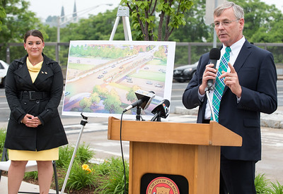 06/01/18  Wesley Bunnell | Staff  Mayor Erin Stewart along with city and state officials as well as developers held a press conference on Friday afternoon at the CTFastrak Station to kick off the start of Beehive Bridge Project. CT DOT Commissioner James P. Redeker speaks to the attendees as Mayor Stewart stands off to the side near a rendition of the bridge project.
