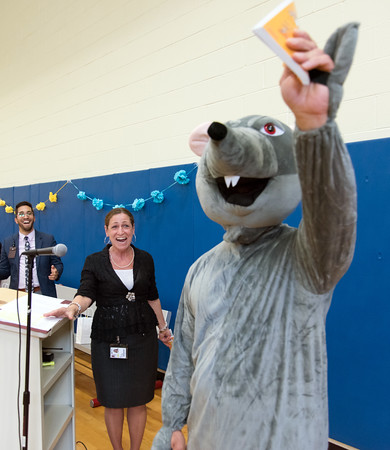 06/01/18 Wesley Bunnell | Staff Lincoln Elementary School Vice President Orlando Ruiz, L, and Principal Lisa Torres react as a mouse enters the school gymnasium on Friday afternoon. Lincoln Elementary School held their One School, One Book event on Friday afternoon giving every student the same book, The Mouse on the Motorcycle, to bring home to be read with their parents. The books were wrapped with the title kept a secret until being passed out.