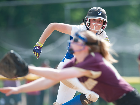 06/01/18 Wesley Bunnell | Staff Southington defeated South Windsor 1-0 on Friday afternoon to advance to the Class LL Semi Final Tournament game. Sarah Myrick (19) watches as the South Windsor first baseman Megan Lemay (16) makes a diving catch for the out.
