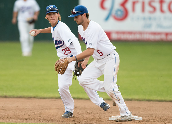06/12/18 Wesley Bunnell | Staff The Bristol Blues vs the Worcester Bravehearts at Muzzy Filed on Tuesday night. Short stop Ryan Lutz (29) keeps the grounder himself to touch second base and turn the double play as Ian Ostberg (5) moves out of the way.