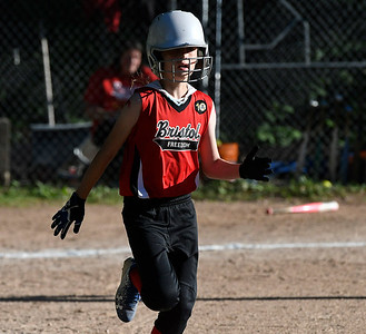6/15/2018 Mike Orazzi | Staff Freedom's Madison Charette (8) during city softball in Rockwell Park Friday evening.
