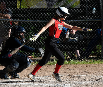 6/15/2018 Mike Orazzi | Staff Freedom's Emily Valentine (10) during city softball in Rockwell Park Friday evening.