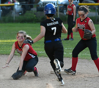 6/15/2018 Mike Orazzi | Staff The Black Panthers' Adrianna Rappleyea (7) and Freedom's Grace Higgins (12) during city softball in Rockwell Park Friday evening.