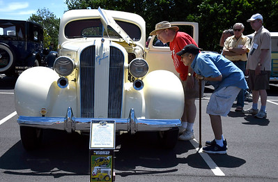 6/16/2018 Mike Orazzi | Staff David Alaimo and Carl Antunes look over a 1937 Graham- Paige Supercharged Coupe during the Klingberg Vintage Motorcar Series Saturday.