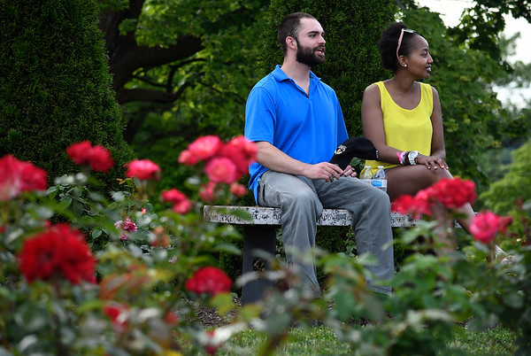 6/16/2018 Mike Orazzi | Staff Ken Petroski and Damaris Thuita while enjoying the fifth annual New Britain Rose Garden Festival Saturday evening in Walnut Hill Park.