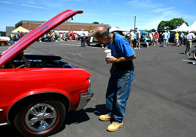 6/16/2018 Mike Orazzi | Staff Norm Brochu looks over a  1964 Pontiac GTO during the Klingberg Vintage Motorcar Series Saturday.
