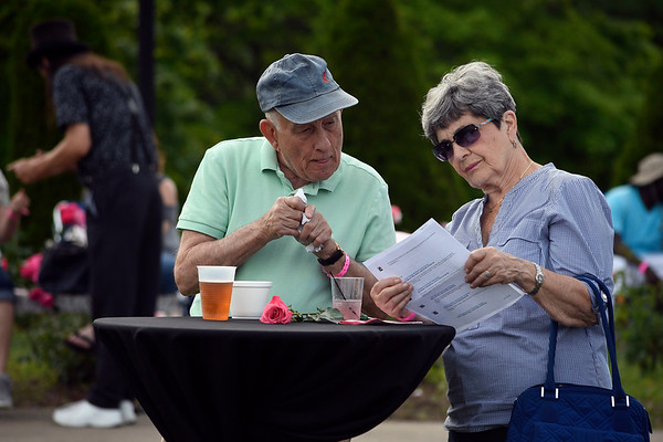 6/16/2018 Mike Orazzi | Staff Paul Gianaris and Mary Ann Rusczyk during the fifth annual New Britain Rose Garden Festival Saturday evening in Walnut Hill Park.