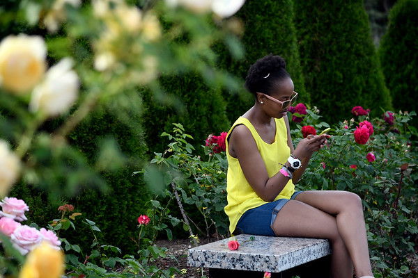 6/16/2018 Mike Orazzi | Staff Damaris Thuita while enjoying the fifth annual New Britain Rose Garden Festival Saturday evening in Walnut Hill Park.