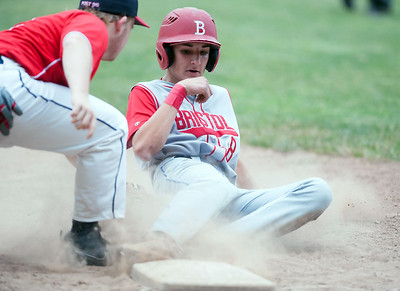Nick Ruffino (8) is out at third.