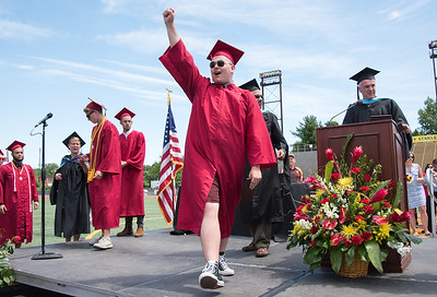 06/19/18  Wesley Bunnell | Staff  New Britain High School graduating senior Robert Breau III holds his fist up as he walks off stage after receiving his diploma during graduation exercises at Veterans' Memorial Stadium at Willow Brook Park on Tuesday morning.