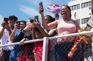 06/19/18  Wesley Bunnell | Staff  Family and friends of graduating NBHS seniors shout their names and smile as try to get their attention just prior to their graduation exercises at Veterans' Memorial Stadium at Willow Brook Park on Tuesday morning.