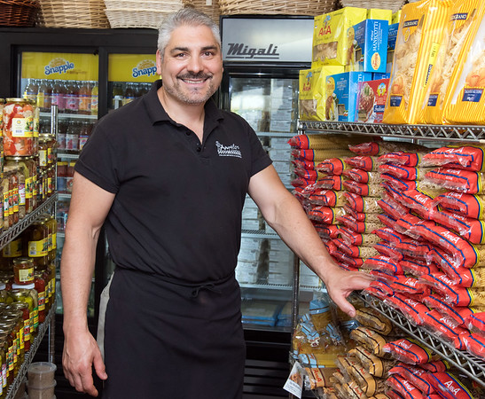 Owner Joe Tropea stands with the many kinds of pasta stocked at Angelo's Market.