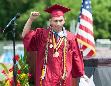 06/19/18  Wesley Bunnell | Staff  New Britain High School Salutatorian Manuel Rivas pumps his fist walking off stage after delivering his address during graduation exercises at Veterans' Memorial Stadium at Willow Brook Park on Tuesday morning.