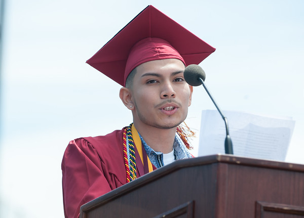 06/19/18 Wesley Bunnell | Staff New Britain High School Salutatorian Manuel Rivas delivers his address during graduation exercises at Veterans' Memorial Stadium at Willow Brook Park on Tuesday morning.