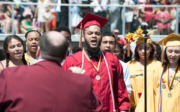 06/19/18 Wesley Bunnell | Staff Graduating senior Giovanni Cirinna performs along with the Show Choir and Treble Choir at New Britain High School's graduation exercises at Veterans' Memorial Stadium at Willow Brook Park on Tuesday morning.