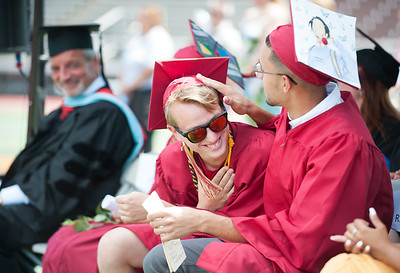06/19/18  Wesley Bunnell | Staff  Nicholas Christopher Makuch smiles after being mentioned by Valedictorian Gabriella Roy during her commencement speech as he sits next to Guillermo Burgos. New Britain High School held their graduation exercises at Veterans' Memorial Stadium at Willow Brook Park on Tuesday morning.