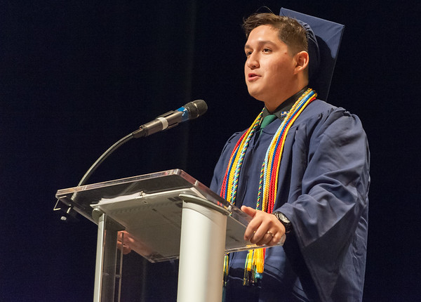 06/21/18 Wesley Bunnell | Staff Newington High School 2018 Class President Kevin Zvonarek gives his welcome address the school's commencement ceremony at The Oakdale Theatre on Thursday evening.