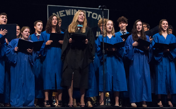 06/21/18 Wesley Bunnell | Staff Newington High School Principal Terra Tigno and the school's choir perform a rendition of Journey's Don't Stop Believin'.