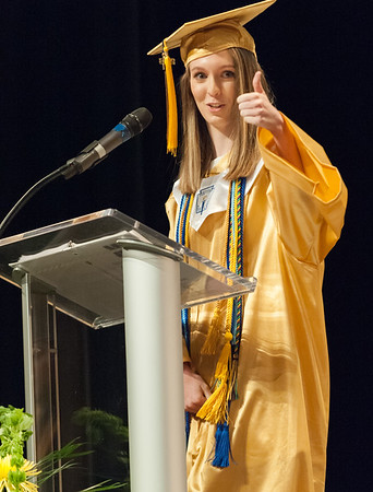 06/21/18 Wesley Bunnell | Staff Newington High School 2018 Salutatorian Jessica Buslewicz gives the thumbs up to her sister in the audience during the school's commencement ceremony at The Oakdale Theatre on Thursday evening.