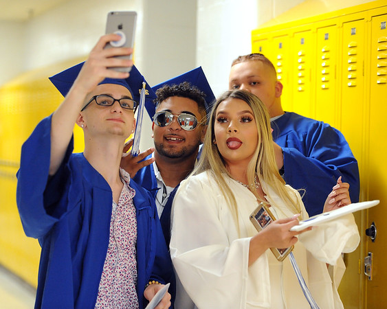 6/21/2018 Mike Orazzi | Staff Owen Hailstones, Christian Vargas, Lissette Urena and Davian Lopez during Southington High School's graduation Thursday evening.