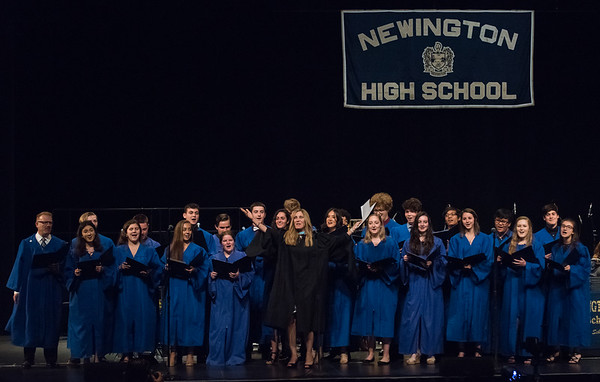 06/21/18 Wesley Bunnell | Staff Newington High School Principal Terra Tigno raises her arms as she and the school's choir perform a rendition of Journey's Don't Stop Believin'.