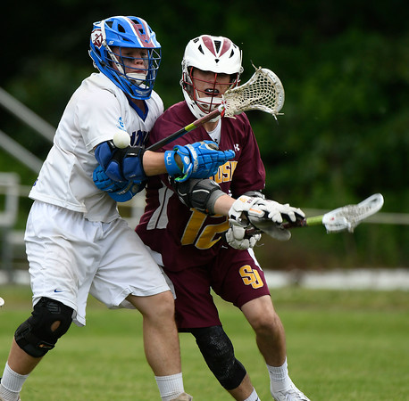 6/2/2018 Mike Orazzi | Staff St. Paul boys lacrosse's Christopher Dionne (7) and St. Joseph's Nick Macisco (12) during the Class S Quarterfinal lacrosse match in Bristol Saturday.