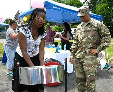 6/2/2018 Mike Orazzi | Staff Dineille Villardel plays a steel drum as CT National Guard Sgt. Chris Boyle looks on during the Arch Street Neighborhood Revitalization Zone Build-A-Better-Block celebration held on Arch Street Saturday afternoon.