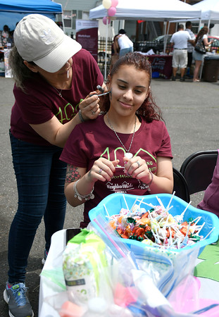 6/2/2018 Mike Orazzi   Staff Maria Rosiello paints a small house on Priscilla Garica's cheek during the Arch Street Neighborhood Revitalization Zone Build-A-Better-Block celebration held on Arch Street Saturday afternoon.