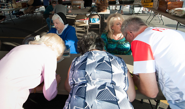 06/21/18 Wesley Bunnell | Staff Visitors buy raffle tickets on first night of the Sacred Heart Parish Festival on Friday evening.