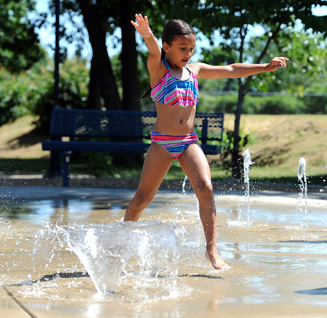 6/26/2018 Mike Orazzi | Staff Amaya Perez while cooling off in the splash pad at the E.G. Stocks Playground in Bristol Tuesday.