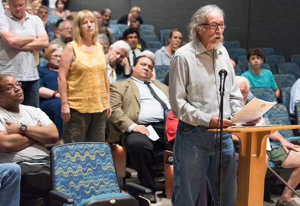 06/26/18 Wesley Bunnell | Staff A presentation was held on Tuesday evening at Gaffney Elementary School regarding Tilcon's proposed expansion of its quarry into a New Britain owned watershed area. John Kristopik speaks in front of the city council.