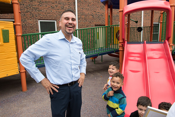 06/27/18 Wesley Bunnell | Staff Representative Bobby Sanchez smiles as he stands on the playground next to 3-5 year students including Heriberto Luna and Reilyn Ruiz at the YWCA on Wednesday afternoon prior to receiving an award from Executive Director Merrill Gay from the Connecticut Early Childhood Alliance. The students are part of Esther Cruz's Giraffes class at the YWCA.