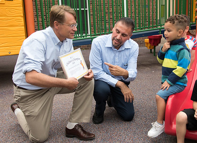 06/27/18  Wesley Bunnell | Staff  Executive Director of the Connecticut Early Childhood Alliance Merrill Gay, L, holds an award for Representative Bobby Sanchez as they talk to students including Reilyn Ruiz who is in Esther Cruz's Giraffes's Class at the YWCA on Wednesday afternoon.