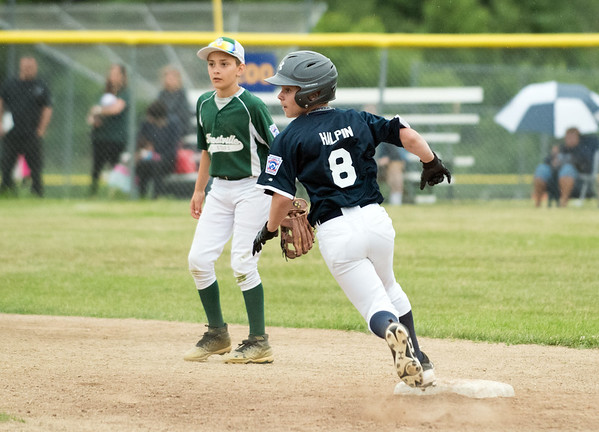 06/27/18 Wesley Bunnell   Staff Forestville Little League defeated Southington North 2-0 on Wednesday afternoon in Southington. Aiden Halpin (8) rounds second base and thinks about third before retreating.