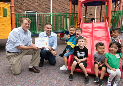06/27/18  Wesley Bunnell | Staff  Executive Director of the Connecticut Early Childhood Alliance Merrill Gay presents Representative Bobby Sanchez with an award as they kneel next to students from Esther Cruz's 3-5 year old's Giraffe's Class at the YWCA on Wednesday afternoon. Students are Reilyn Ruiz, Heriberto Luna, Zayden Kosikas, Mason King, Kamila Rondon and Isaiah Benitez.