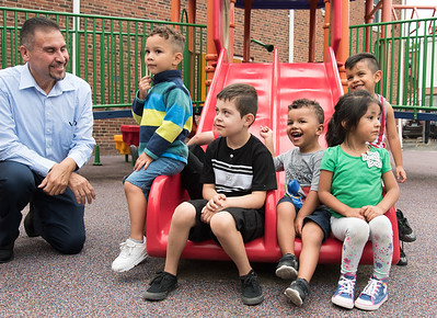 06/27/18  Wesley Bunnell | Staff  Representative Bobby Sanchez smiles as he kneels next to 3-5 year old students in Esther Cruz's Giraffe's Class at the YWCA on Wednesday afternoon. Representative Sanchez received an award from Executive Director Merrill Gay from the Connecticut Early Childhood Alliance.  Students are Reilyn Ruiz, Zayden Kosikas, Mason King, Kamila Rondon and Isaiah Benitez.