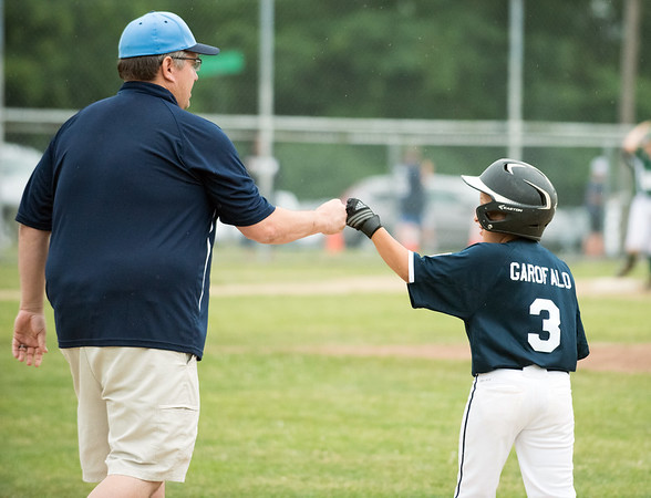 06/27/18 Wesley Bunnell | Staff Forestville Little League defeated Southington North 2-0 on Wednesday afternoon in Southington. Joseph Garofalo (3) fist bumps the first base coach after coming in to pinch run in the bottom of the 6th.