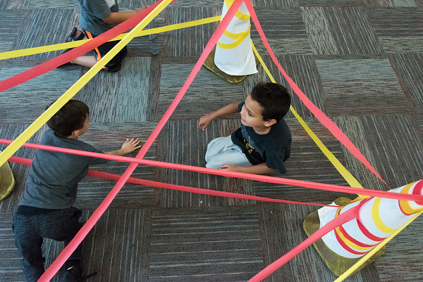 06/28/18 Wesley Bunnell | Staff Adam Tartt, R age 9, sits in the obstacle course of fire at the Tween Time Olympics at the New Britain Public Library on Thursday afternoon. The event is designed to bridge the gap from youth to teen events in the library.