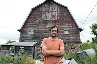 06/27/18  Wesley Bunnell | Staff  Owner Brent Biederman stands in front of a barn on Rooster Rise Farm in Berlin which is currently undergoing renovations.
