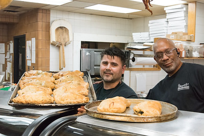 06/29/18  Wesley Bunnell | Staff  Workers pose with trays of freshly prepared spinach pies at Angelo's Market on Friday afternoon.