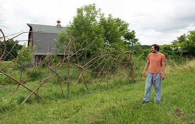 06/27/18  Wesley Bunnell | Staff  Owner Brent Biederman points out a hand made fence made with cut down trees at Rooster Rise Farm in Berlin which is currently undergoing renovations.