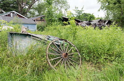 06/27/18  Wesley Bunnell | Staff  An old wheel leans against a small shed on the property of Rooster Rise Farm which is currently undergoing renovations by owner Brent Biederman who purchased the property two years ago.