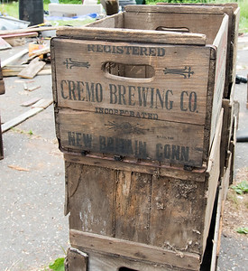 06/27/18  Wesley Bunnell | Staff  Old wooden boxes including original Cremo Brewing Co are shown behind Rooster Rise Farm in Berlin during the farms renovation.