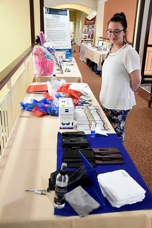 6/30/2018 Mike Orazzi | Staff Walmart Vision Center's Amber Loomis during the Wise & Well Health Fair held at Atria in Farmington Saturday.