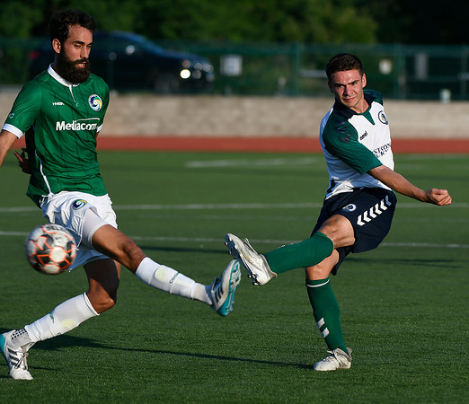 6/30/2018 Mike Orazzi | Staff Hartford City FC's Luke Alvaro (17) and the New York Cosmos' Alejandro Penzini (4) during Saturday evening's match at CCSU in New Britain.